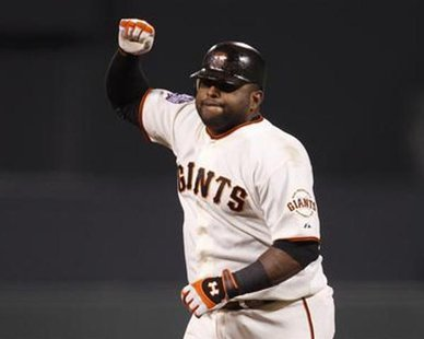 San Francisco Giants' Pablo Sandoval celebrates his third home run of the game against the Detroit Tigers in the fifth inning during Game 1 of the MLB World Series baseball championship in San Francisco, October 24, 2012. REUTERS/Robert Galbraith