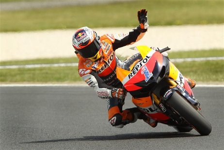 Honda MotoGP rider Casey Stoner of Australia waves during a free practice session ahead of the Australian Motorcycle Grand Prix at Phillip I