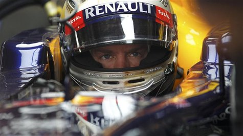 Red Bull Formula One driver Sebastian Vettel of Germany sits in his car during the first practice session of the Indian F1 Grand Prix at the
