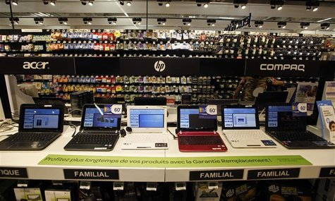 Laptop computers are displayed for sale at a supermarket in Nice August 23, 2012. REUTERS/Eric Gaillard