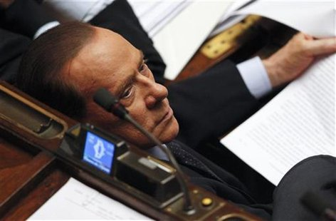 Former Italian Prime Minister Silvio Berlusconi looks on during a vote of confidence at the Lower House of Parliament in Rome November 18, 2