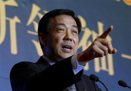 Bo Xilai, then Governor of Liaoning Province, gestures as he delivers a speech at the China Entrepreneur Annual Meeting 2003 in Beijing in t