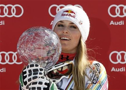 Lindsey Vonn of the U.S. Celebates with her trophy after winning the Alpine skiing women's overall World Cup at the Alpine skiing World Cup