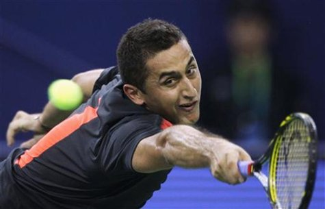 Nicolas Almagro of Spain hits a return during his single's tennis match against Tommy Haas of Germany at the Shanghai Masters tournament in