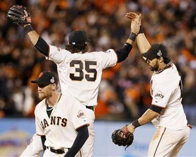 DRESS REHERSAL FOR WEEKEND?: San Francisco Giants center fielder Angel Pagan (R) celebrates with teammates Brandon Crawford (35) and Hunter Pence after the Giants defeated the Detroit Tigers in Game 2 of the MLB World Series baseball championship in San Francisco, October 25, 2012. REUTERS/Lucy Nicholson