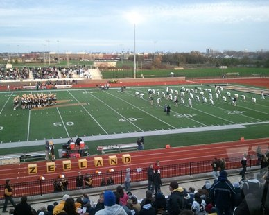 Players for both Zeeland East (L) and Zeeland West (R) warm up prior to the MHSAA Division 3 district semifinal game at Zeeland Stadium, won by the West Dux 46-0, on Oct. 26, 2012.
