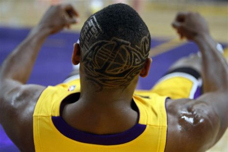 Los Angeles Lakers Ron Artest displays a Lakers logo haircut during their NBA basketball game against the Los Angeles Clippers in Los Angele