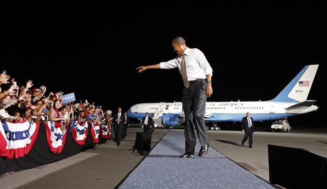 U.S. President Barack Obama points to the crowd as he arrives for a campaign rally in Cleveland, Ohio October 25, 2012. REUTERS/Kevin Lamarq