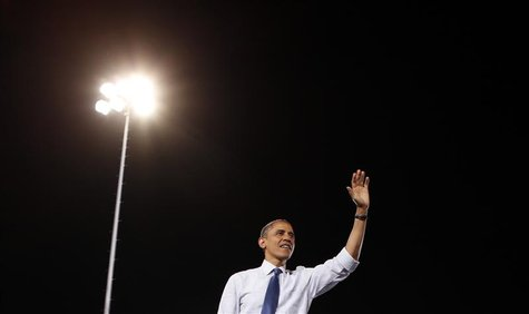 U.S. President Barack Obama waves to supporters after speaking at a campaign rally in Las Vegas, Nevada October 24, 2012. REUTERS/Kevin Lama