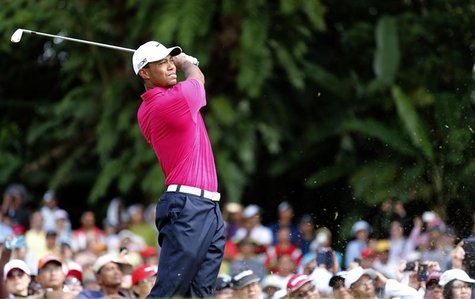 Tiger Woods of the U.S. tees off on the first hole during the third round of Malaysia's Asia Pacific Classic golf tournament in Kuala Lumpur