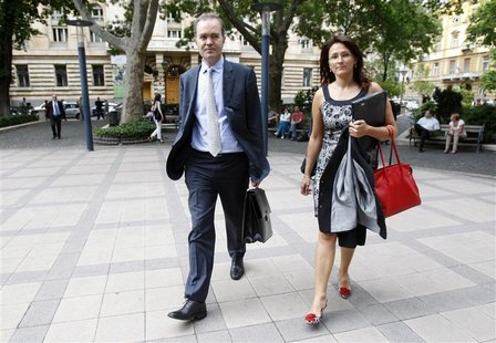 The IMF's Mission Chief for Hungary, Thanos Arvanitis (L) and the Fund's Representative in Hungary Iryna Ivaschenko walk in the streets of B