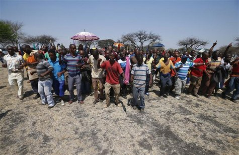 Striking platinum miners march near the Anglo-American Platinum (AMPLATS) mine near Rustenburg in South Africa's North West Province in this