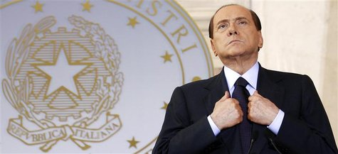 Then Italian Prime Minister Silvio Berlusconi looks on as he leads a news conference with French President Nicolas Sarkozy at Villa Madama i