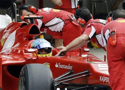 Ferrari Formula One driver Fernando Alonso of Spain is pushed into his garage during the qualifying session of the Indian F1 Grand Prix at t