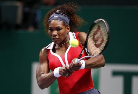 Serena Williams of the U.S. hits a return to Poland's Agnieszka Radwanska during their semifinals WTA tennis championships match in Istanbul