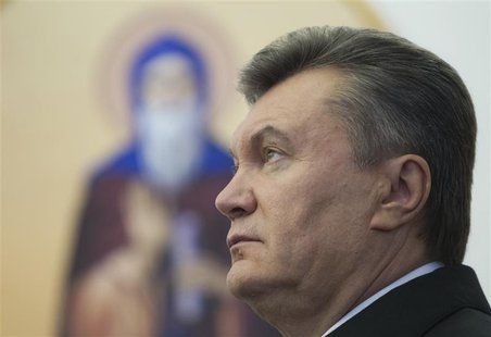 Ukrainian President Viktor Yanukovich attends a ceremony to mark the opening of a church on a military base in Kiev October 26, 2012. REUTER