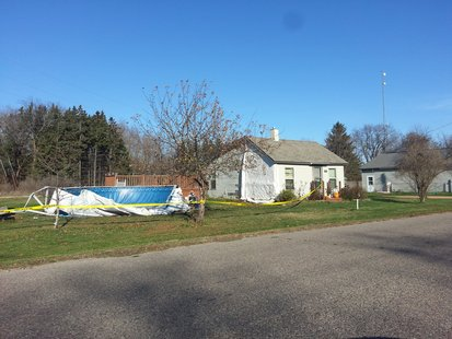 House and pool damaged by drunk driver 10/27/12 in Amherst Junciton, WI