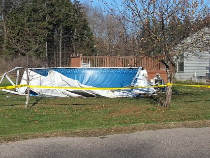 Above ground swimming pool damaged by a drunk driver in Amherst Junction 10/27/12.  The driver also struck the house injuring a sleeping couple.