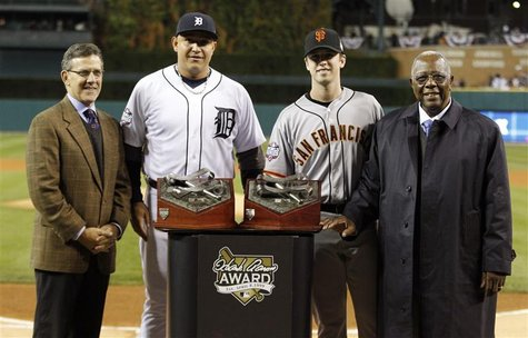Detroit Tigers third baseman Miguel Cabrera (2nd from L) and San Francisco Giants catcher Buster Posey (2nd from R) are flanked by Tim Brosn