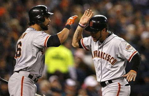 San Francisco Giants' Angel Pagan (L) congratulates Gregor Blanco after he scored against the Detroit Tigers in the second inning during Gam