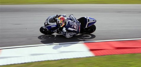 Yamaha MotoGP test rider Katsuyuki Nakasuga of Japan takes a corner during the first free practice session at the Malaysian Grand Prix at Se