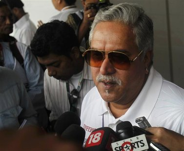 Force India team principal Vijay Mallya talks to the media in the paddock during the third practice session of the Indian F1 Grand Prix at t