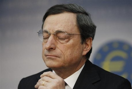 The European Central Bank (ECB) President Mario Draghi reacts during the monthly news conference in Frankfurt, February 9, 2012. REUTERS/Ale