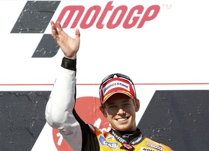 Honda MotoGP rider Casey Stoner of Australia celebrates winning the Australian Motorcycle Grand Prix at Phillip Island October 28, 2012. REU