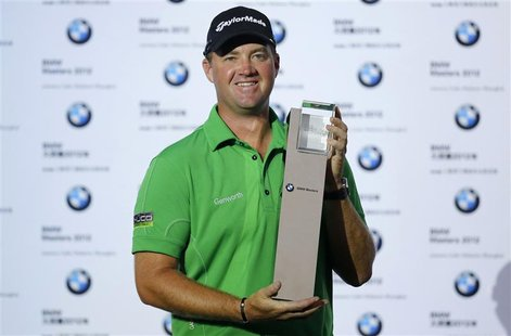 Peter Hanson of Sweden poses with his trophy after winning the BMW Masters 2012 golf tournament at Lake Malaren Golf Club in Shanghai, Octob