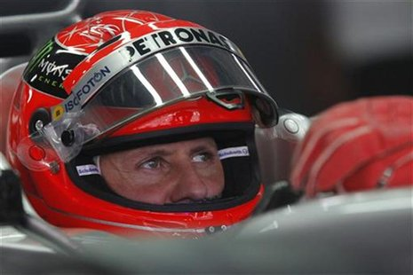 Mercedes Formula One driver Michael Schumacher of Germany sits in his car during the third practice session of the Indian F1 Grand Prix at t