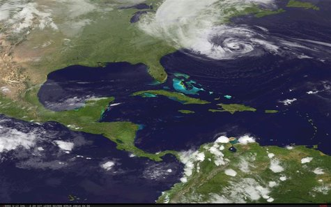 Hurricane Sandy is pictured off the east coast of the United States in this October 28, 2012 NASA handout satellite image. REUTERS/NASA/Hand