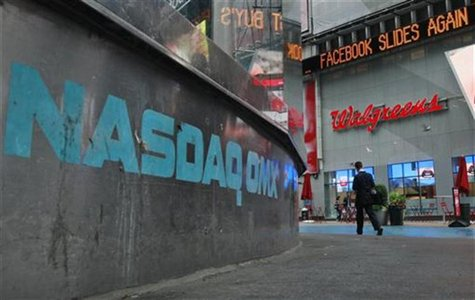 The Nasdaq logo is seen on the exterior of the Nasdaq MarketSite as a headline about the Facebook stock scrolls on the Times Square Newstick