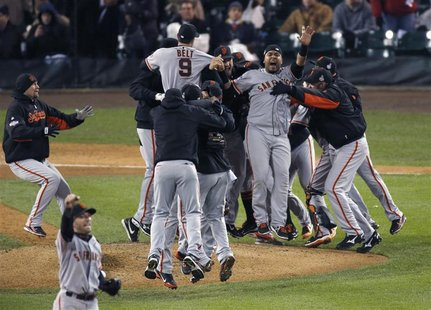San Francisco Giants players celebrate after defeating the Detroit Tigers to win the MLB World Series baseball championship in Detroit, Mich