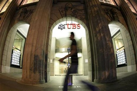 A man walks in front of the office of Swiss bank UBS in the Bahnhofstrasse in Zurich August 10, 2012. REUTERS/Arnd Wiegmann