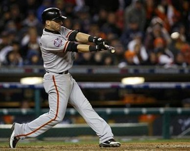 San Francisco Giants' Marco Scutaro hits an RBI single against the Detroit Tigers in the tenth inning during Game 4 of the MLB World Series baseball championship in Detroit, Michigan, October 28, 2012.  REUTERS/Mark Blinch
