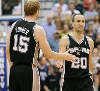 San Antonio Spurs power forward Matt Bonner (15) congratulates shooting guard Manu Ginobili (20) during the second half of their NBA basketb