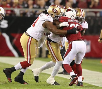 Arizona Cardinals LaRod Stephens-Howling gets smothered by San Francisco 49ers defense in the first half during their NFL football game in P