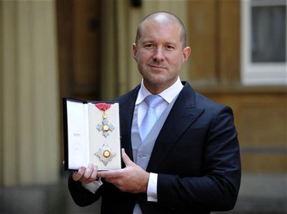 Jonathan Ive, senior vice president of industrial design at Apple Inc poses with his with his Knight Commander of the Order of the British E