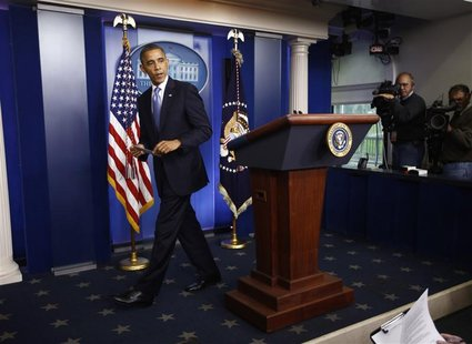 U.S. President Barack Obama walks from the podium after delivering a statement on the Hurricane Sandy situation from the press briefing room