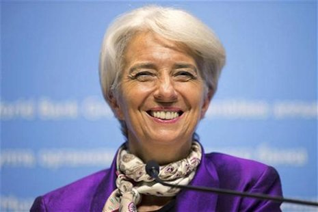 International Monetary Fund (IMF) Managing Director Christine Lagarde smiles as she answers a questions during a news conference at the IMF