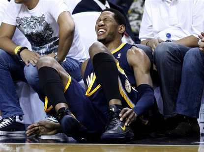 Indiana Pacers' Danny Granger grabs his ankle after he was injured in the second quarter of play against the Miami Heat during Game 5 of the