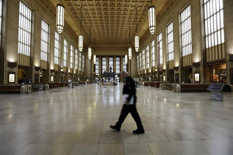 An Amtrak police officer patrols the empty 30th Street Station after all rail travel was cancelled due to damage caused by Hurricane Sandy i