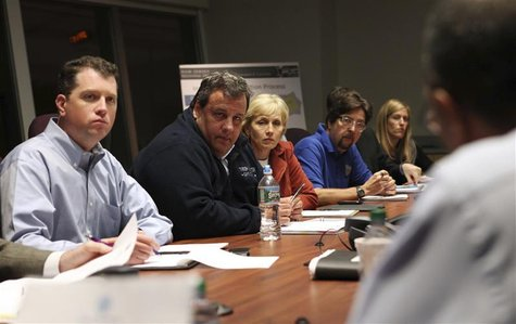 Chief of Staff Kevin O'Dowd, Governor Chris Christie, Lt. Governor Kim Guadagno and Chief Counsel Charlie McKenna (L-R) are briefed by New J