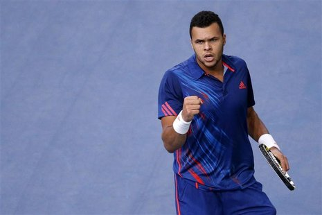 Jo-Wilfried Tsonga of France reacts during his match against Julien Benneteau of France during the Paris Masters tennis tournament October 3