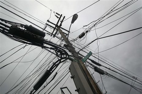 Power lines devastated by fire and the effects of Hurricane Sandy are seen in the Breezy Point section of the Queens borough of New York Oct