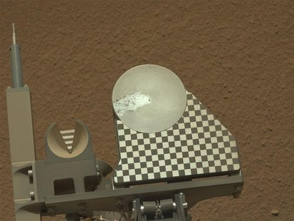 A sample of Martian soil delivered by the robotic arm on NASA's Mars rover Curiosity to the rover's observation tray for the first time is p