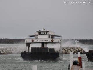 With waves crashing in the background, the Washington Island Ferry returns to Northport Pier in Door County, Oct. 30, 2012. The high waves and choppy water were a result of the western edge of Super storm Sandy skirting Northeast Wisconsin. (courtesy of FOX 11).