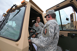 Two members of Wisconsin National guard ready for deployment.