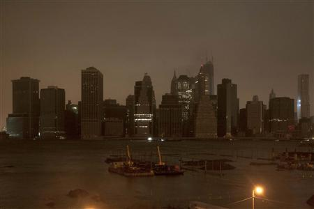 The skyline of lower Manhattan sits in darkness after a preventive power outage in New York October 29, 2012. Hurricane Sandy could be the biggest storm to hit the United States mainland when it comes ashore on Monday night, bringing strong winds and dangerous flooding to the East Coast from the mid-Atlantic states to New England, forecasters said on Sunday.
