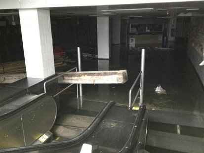 The South Ferry subway station entrance in Lower Manhattan in the aftermath of Hurricane Sandy is seen in this handout photo from the MTA, i